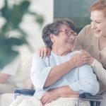 Elderly female spending time with female caretaker